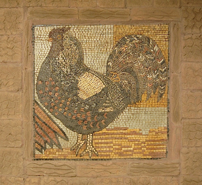 rooster mosaic on the floor of Patis Tito Garden Café