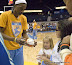 Sylvia Fowles #34 autographs a ball during the captain's meeting. (WNBA: Chicago Sky 59 v. New York Liberty 64, Allstate Arena, Rosemont, IL., July 6, 2012)