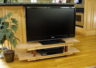 Photo: The same TV stand.  Measures 48 inches wide, 11 inches deep, and 12 inches high.
