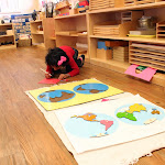 Look at the space she has to work with her Montessori continents puzzle map! An open, spacious, unhurried environment is key for children to joyfully explore with all their senses.