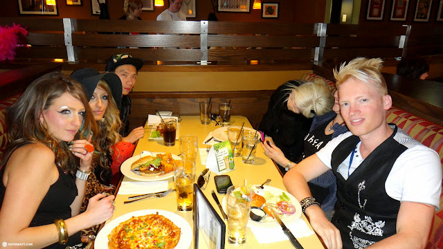 eats at boston pizza after the fashion show in Mississauga, Ontario, Canada