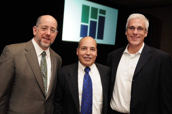 Photo of (from left to right) OFN President/CEO Mark Pinsky; Federation Director of Membership Pablo DeFilippi; and OFN Board Chairman Ignacio Esteban or the Florida Community Loan Fund.