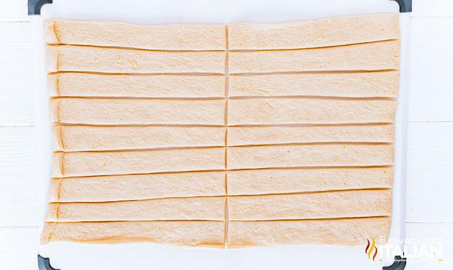 Air Fryer Garlic Knots dough cut into strips