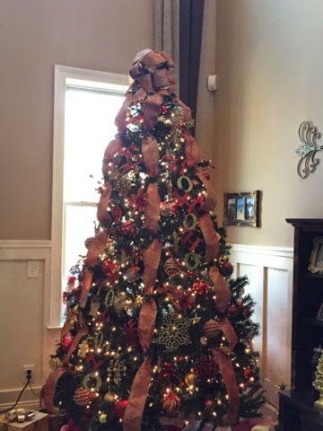 this is our 9 ft main tree in our living room with all red and gold ornaments it was the subject of my recent post of christmas tree decorating tips