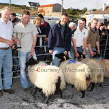 Sean Graven presents The Graven Family Cup for the Ewe Lamb (confined) class to Martin Calvey, Dookinella at the 21st Achill Sheep Show (Taispeántas Caorach Acla 2007)  at Pattens Bar, Derreens Achill; 2nd prize was won by  Sean Gallagher, Currane; 3rd  Stephen O'Malley, Currane and 4th to Pat Vesey The Valley.  .Photo: © Michael Donnelly