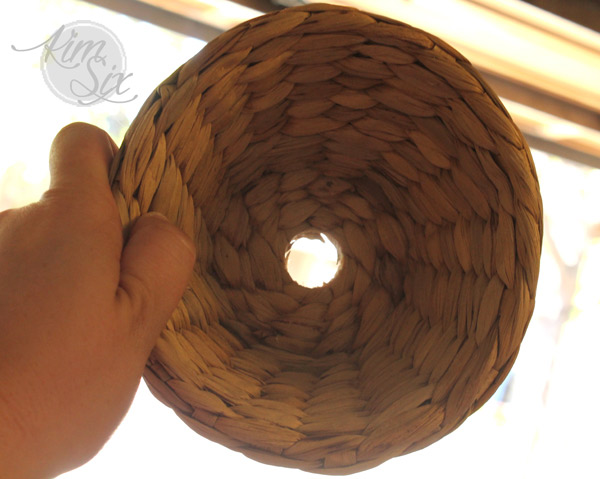 Drilling a hole into a wicker basket