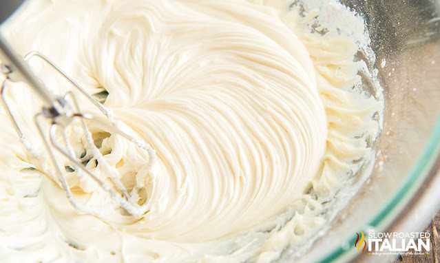 beating frosting with an electric mixer