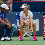 Genie Bouchard chats with her coach