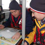 Crew Members Oli Mallinson and Glen Mallen at the chart table, working out the tides for a search, on exercise on Sunday 20 January 2013 Photo: RNLI Poole/Dave Riley