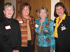 Mary Linn Darlage, speaker Mary King, Stacey McMullen and Cari Perlingiero visit at the Theta-Chi O mixer.