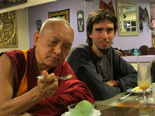 Lama Zopa Rinpoche enjoying green tea icecream with Osel in California, February 2011