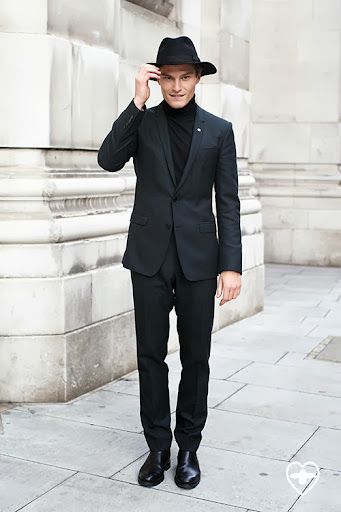 Oliver Cheshire: model; Lock and Co. hat; Dolce and Gabbana suit; COS jumper; Russell and Bromley shoes;