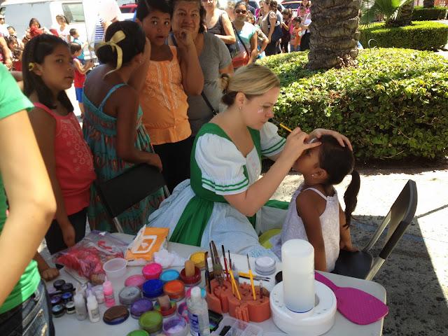 Kids enjoying face painting activities