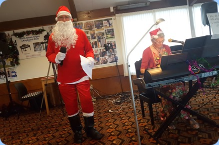 Santa even found time to participate in the chorus for the great Christmas song played by Jeanette Harding.