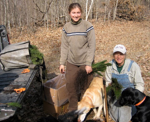 Kira and daughter Myra with their dogs set to plant trees in the skinny field