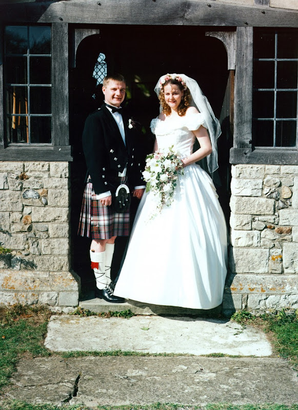 Newly wedded couple standing outside a church in Scotland