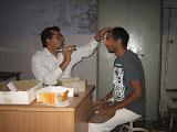 The eye doctor examines a volunteer's eyes