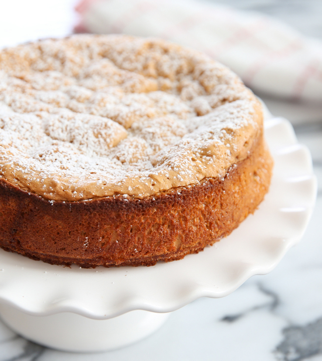photo of a flourless peanut butter cake garnishes with powdered sugar