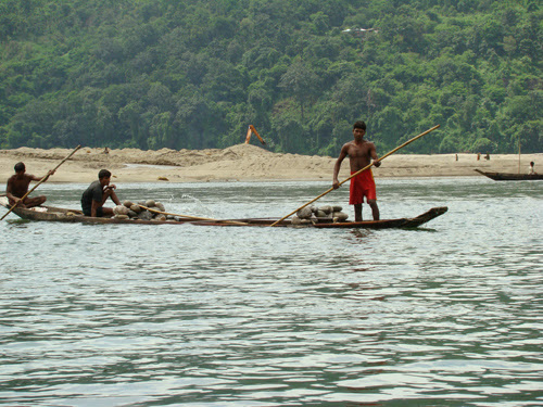 Collecting stone in the boat at Jaflong