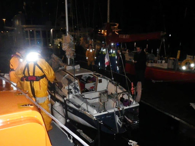 Poole all-weather lifeboat escorting an 8m yacht to Poole Quay Boat Haven after the yacht had grounded on Hook Sands - 1 May 2014 Photo: RNLI Poole