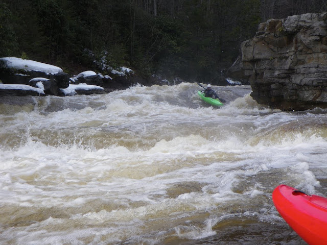 Chris Schwer running a stout hole on the Lower Blackwater--a great alternative to the hill on those cold, snowy days.