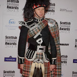 WWW.ENTSIMAGES.COM -    Piper and Highland Dancer Neil Esslemont    at    Scottish Fashion Awards  at 8 Northumberland London October 9th 2013                                                 Photo Mobis Photos/OIC 0203 174 1069
