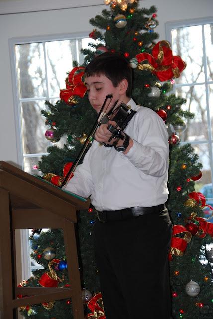 Kalvin on the violin.