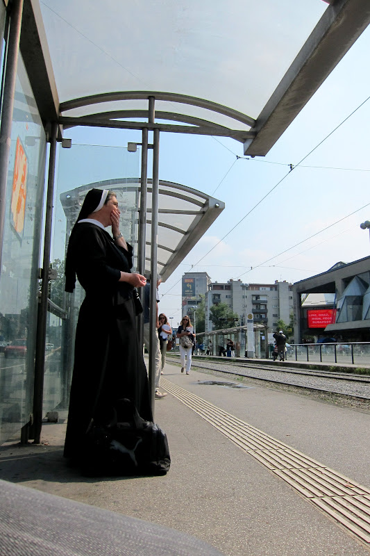 nun waiting for tram