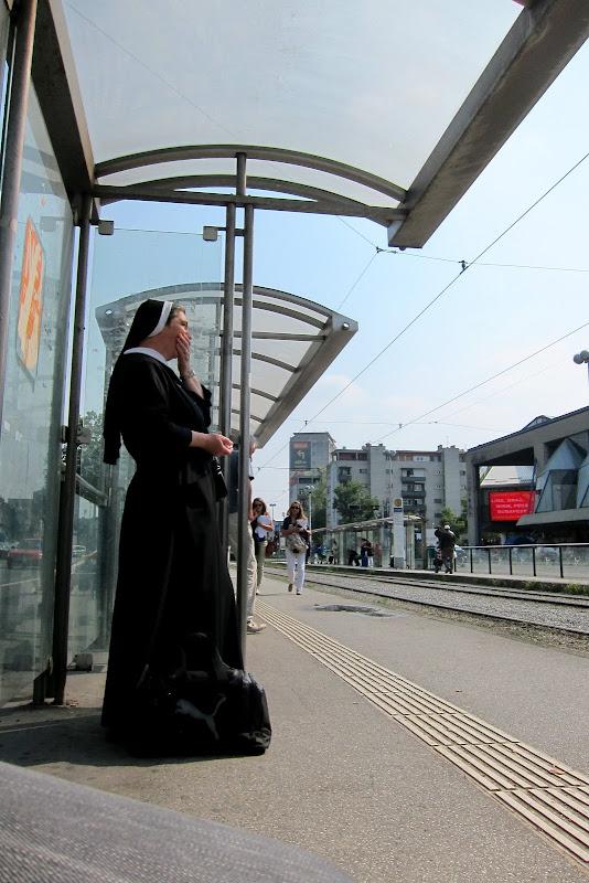 nun waiting for tram