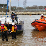 ILB crew members prepare to tow the catamaran up the slipway at Rockley - 24 December 2013.  Photo credit: Steve Axtell