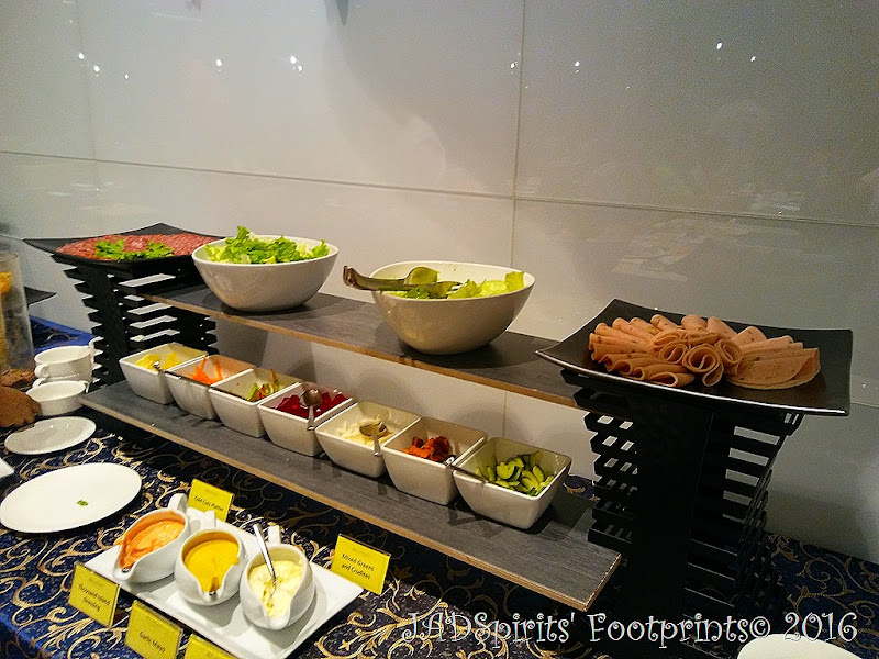 Salad bar with ham and salami and 3 choice of dressings