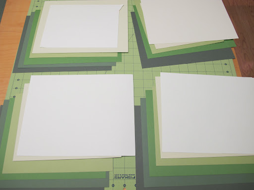 Gradients of green paper being selected for Wednesday's project, which will highlight features of the Paper Trimmer.
