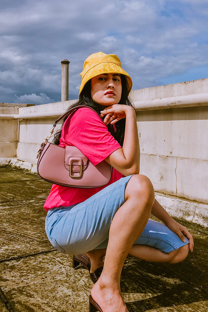 everday outfit for summer wearing neon pink tee and bermuda shorts, outfit inspiration