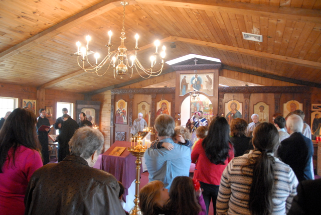 The faithful prepare to partake in Holy Communion.