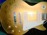 If you're going to sign a Les Paul, sign the whole thing!
