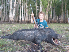 A young Mr Leserer, Germany with his first wild boar. The smile says it all.