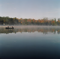 Time for a bit of Canadiana. This picture was taken early in the morning on Jack Lake, at a friends cottage. Daryl and Janet are in the canoe, while I am safely ensconced on the pier taking pictures.  Location: Jack Lake  Camera: Mamiya C330 Dual Lens