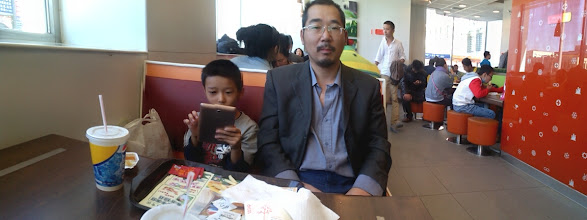Photo: our rich meals during Chinese Mid-Autumn festival 2013. here benzrad with his son warrenzh ate dico's franchise near his mom's house.Thx God, we still afford it. here benzrad with his busy son on his fonepad in Dico's shot by a neighbor girl.
