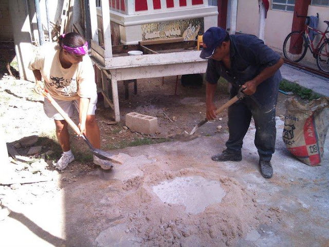 Debbie is trying her hand at mixing concrete, Mexican style.
