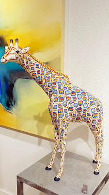 Giraffe by Adam Thomas Rees at Canyon Road Contemporary which is composed of individual printed stamp blocks which he then assembles into a larger sculpture.