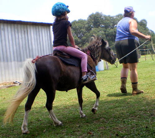 Laura riding LP Painted PuffNstuf with Paula leading