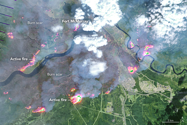 Satellite image of forest fires burning around Fort McMurray, Canada on 4 May 2016. Photo: NASA