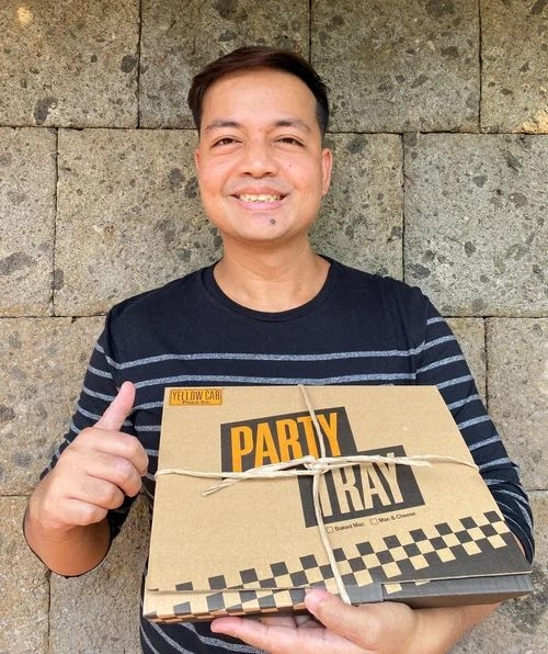 Holding a Yellow Cab Part Pasta Tray