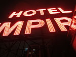 There's a rooftop lounge/bar at the Hotel Empire where you can get up close and personal with its sign