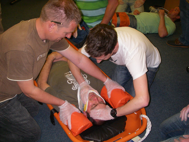 Casualty Care for Lifeboat Crew course – April 2011: crew ensuring that the casualty's head and neck are immobilised so that head chocks can be placed correctly
