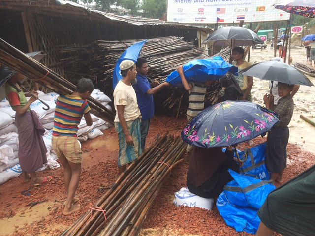 Rohingya refugees in Bangladesh affected by heavy monsoon rains in July 2018 receive IOM shelter materials to help repair and secure their shelters. Photo: IOM