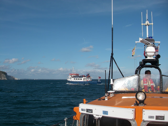 4 September 2011 - Poole all-weather lifeboat standing by the passenger ferry Jurassic Scene after a casualty had been airlifted to Dorchester Hospital. Poole ALB crew then took the casualty's family back to Bournemouth Pier. Photo: RNLI/Poole lifeboat