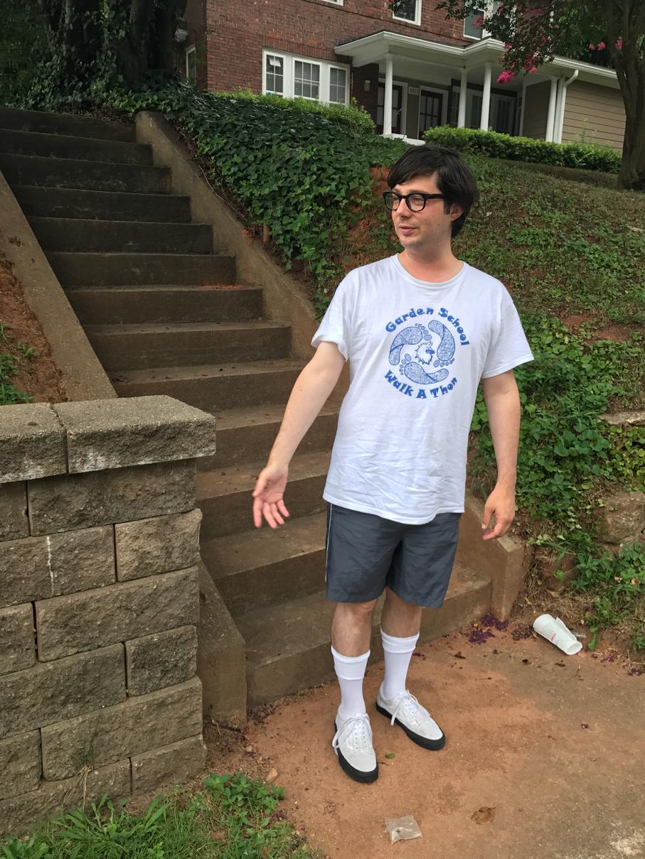 Greig Roselli wears a Garden School Walk-a-Thon t-shirt in Raleigh.