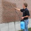 Application of A-Tech Masonry and Brick Sealer to a home's exterior walls.