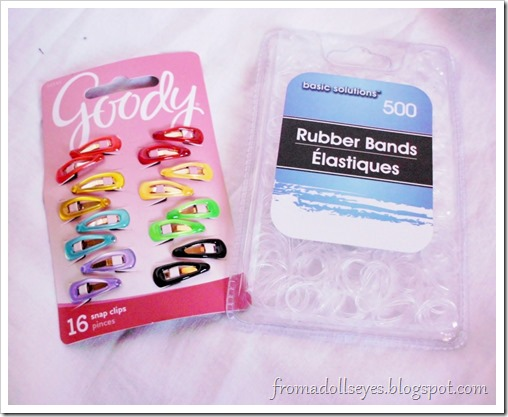 Tiny hair clips and clear rubber bands, useful for doll hair.